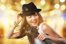 Young Woman Wearing Hat Singin...