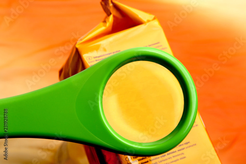 Obraz na plátně Concept of reading ingredients list on food package with magnifying glass