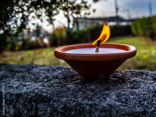 Wall Murals Cemetery Candle on a stone wall