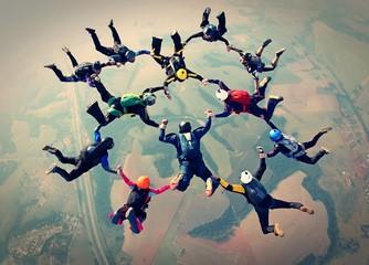 Fototapeta Skydivers team work photo effect