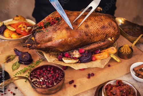 Roasted stuffed goose with herbs berries and vegetables. Ready to Christmas time.