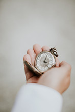 Person Holding A Old Fob Watch...