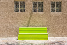 A Bright Green Bench Placed Un...