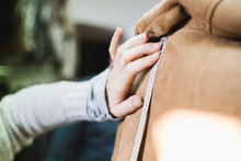 Seamstress Takes The Measurements Of A Leather Jacket