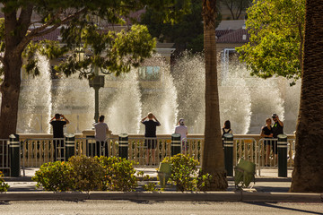 Fototapeta LAS VEGAS, NV, USA - Sptember 12, 2018: Downtown, Las Vegas Strip, daytime.Landmarks, Hotels, Casinos, fountains, Eiffel Tower.