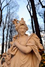 Statue Of Goddess Ceres In Summer Garden.