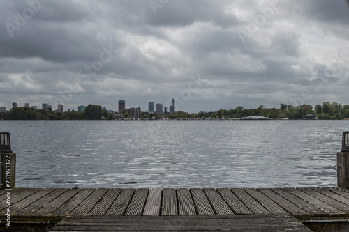 amazing view city of rotterdam from a jetty with a lake in the on a wonderful cloudy and gray day in the Netherlands Holland, copy space or space for text