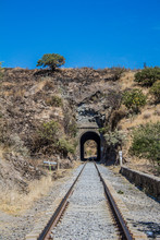 Image Of The Train Tracks With A Tunnel Leading To The Tequila Jalisco Mexico With An Impressive Blue Sky, Copy Space Or Space For Text