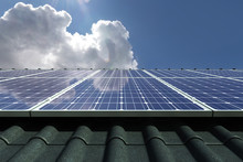 Solar Panels Modules On House Roof With Clear Sky In Background