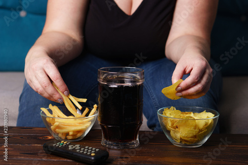Fotomural  overeating, sedentary lifestyle, bad habits, food addiction, eating disorders