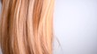 Hair. Beautiful healthy long smooth flowing blond hair closeup texture. Dyed straight hair background. Slow motion. 3840X2160 4K UHD video footage
