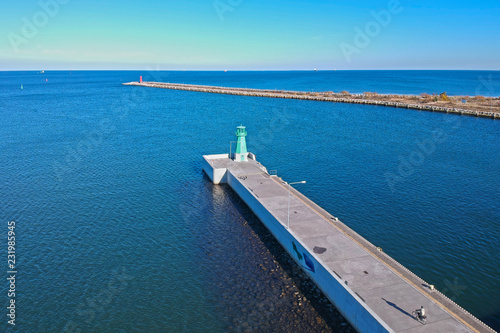 Foto auf Leinwand Leuchtturm Lighthouse at the breakwater of Baltic Sea in Gdansk, Poland