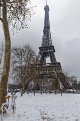 Paris, France - February 7, 2018: The wall for peace in the foreground with the eiffel tower under the snow in the background