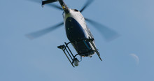 Police Helicopter Lifting Off To Fly Out On Police Operation.