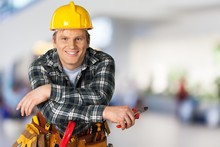 Construction Worker With Tools In Empty Building