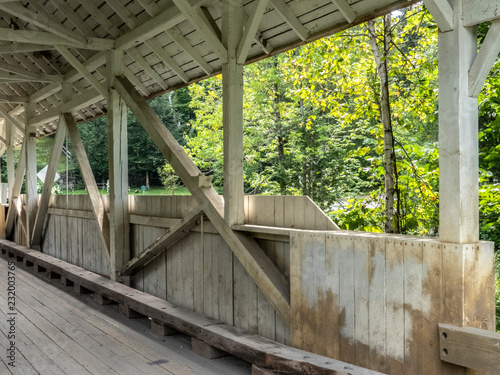 Fotografia, Obraz  Structural side view of covered bridge in Vermont