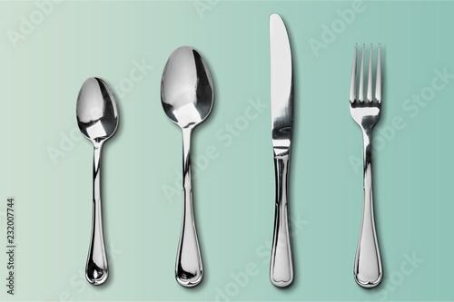 Cuadros en Lienzo  Fork, spoon and knife on blue background
