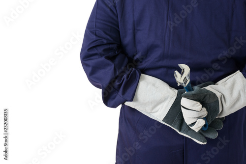 back view portrait of a worker in Mechanic Jumpsuit is holding a wrench isolated on white background