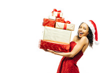 Portrait Of A Very Excited Young Woman In Santa Claus Hat And A Pile Of Gifts