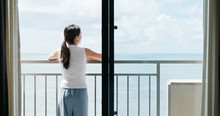 Woman Look At The Sea View In The Balcony