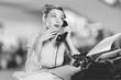 Leinwandbild Motiv Attractive young woman speaking on  vintage phone