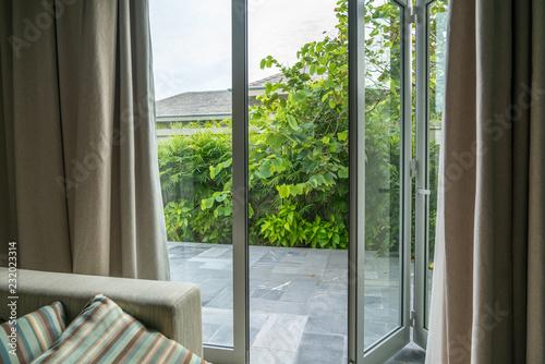 Open window in tropical villa. Summer garden, view outdoor