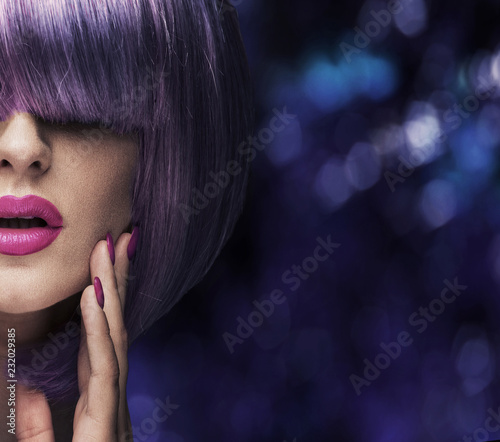 Fashion shot of a pretty lady wearing a purple wig
