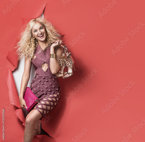 Conceptual picture of a blonde walking through the crocked wall