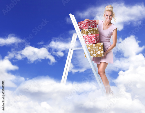 Cheerful lady holding a bunch of gifts - heaven concept