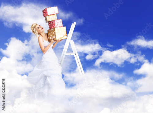 Attractive bride holding a bunch of presents - heaven concept