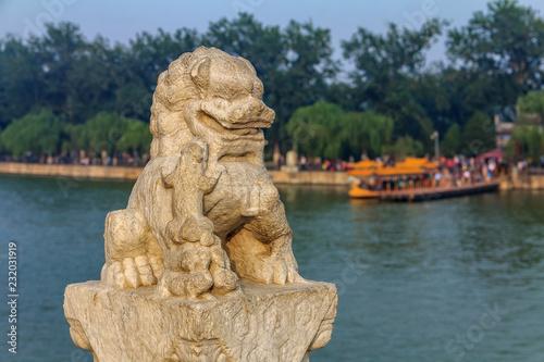 Fotografie, Obraz  Lion sculpture the famous 17 arch lion bridge on Kunming Lake outside of Summer