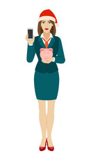 Businesswoman In Santa Hat Hol...