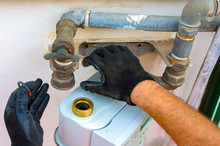 Worker Insert The Seals To The Fitting Between The Pipe And Gas Meter. Selective Focus