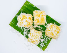 Thai Dessert (Sticky Morsels) Tapioca And Rice Flour With Coconut Milk And Sugar Made Into Little Food Colored Morsels And Sprinkled With Shredded Coconut. Thai Dessert(Khanom Thai)