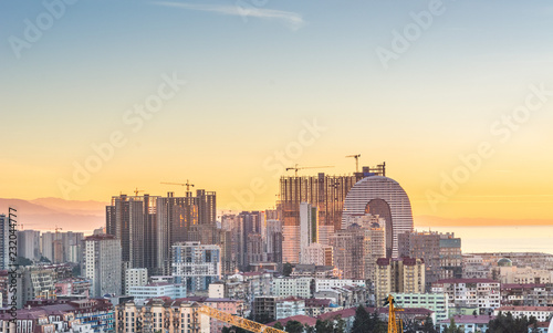 Poster Stad gebouw Batumi, Adjara, Georgia - October 2018: Sunset panoramic view on a new part of Batumi under construction from the one of sky bars. Black sea resort and port city