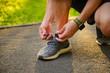 Man tying jogging sport shoes