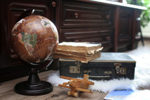 Composition On A Wooden Floor Vintage Globe With Old Leather Suitcase