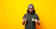 Happy Bearded Hipster Man Usin...