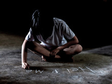 Child Writing Help Me On A Floor With Chalk. Domestic Family Violence And Aggression Concept Violence. Concept For Bullying, Depression Stress Or Frustration.