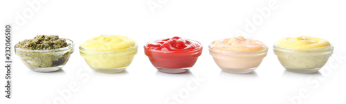 Different tasty sauces in glass bowls on white background Wallpaper Mural
