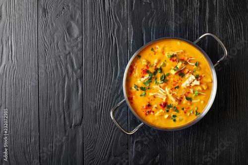 Obraz na płótnie pumpkin chicken breast soup in metal pot