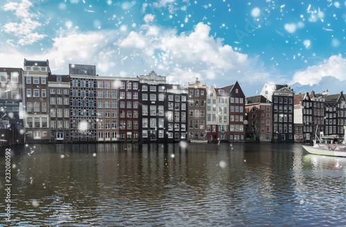 Photo  Typical dutch old houses over canal with snow, Amsterdam, Netherlands