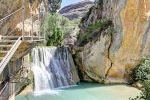 An Idyllic Waterfall In The Ve...