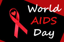 World AIDS Day Concept, Red Ribbon With Small Red Heart On Black And Red Background, An International Day Dedicated To Raising Awareness Of The AIDS