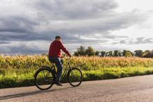 Senior Man Riding Bicycle On C...