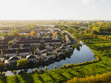 Houses In The Netherlands Surrounded By Water In Morning Light Seen From A Higher Perspective