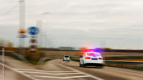 Police car chasing the offender at high speed on the highway . Canvas Print