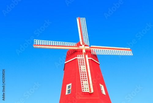 Poster Molens Beautiful red mill against blue sky