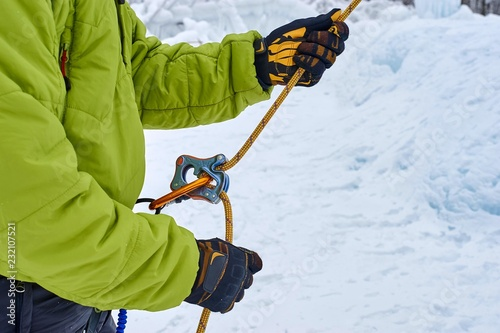Ice climber belay with a rope and click up Wallpaper Mural