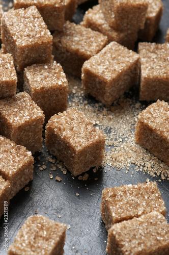 Foto op Canvas Kruiderij Natural brown sugar cubes